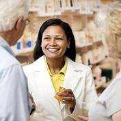 Pharmacist with patients