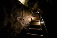 A dimly lit stairway inside Timpanogos Cave