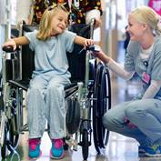 female-nurse-and-girl-on-wheelchair