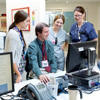 female-nurses-and-male-doctor-computer