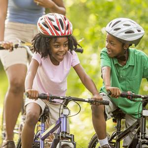 kids on bikes with helmets