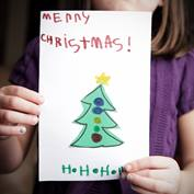 Kid with Christmas Card-square