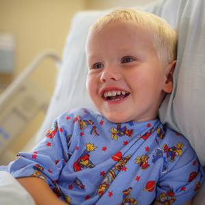 boy-in-hospital-bed-smiling