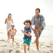 family on beach running_square
