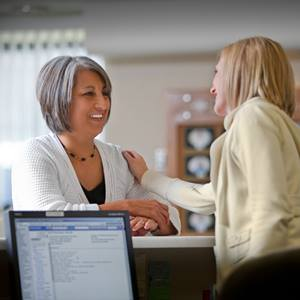 female-office-worker-greeting-patient