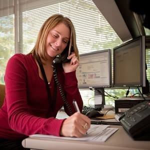female-office-worker-talking-on-phone