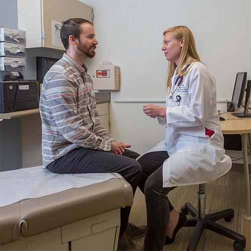 Female dermatologist male patient exam video