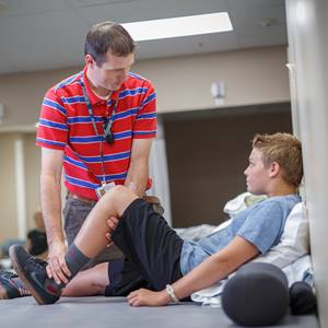 physical-therapist-working-with-young-man