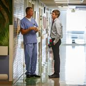 physician-office-worker-talking-in-hallway