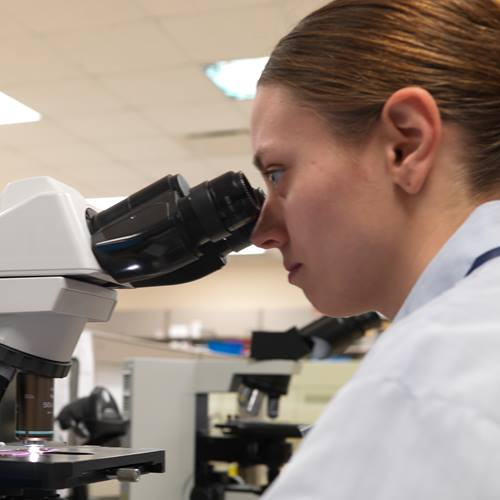 lab-services-woman-microscope-Job_0577-square