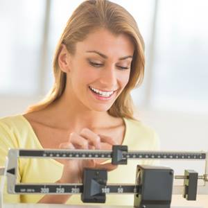A woman checking her weight on the scale
