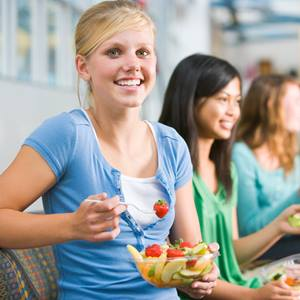 nutrition-young-woman-eating-fruit-1101783-square