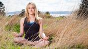live-well-woman-meditating-outdoors-3631172-landscape