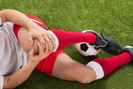 bigstock-Soccer-Player-Suffering-From-K-90570839