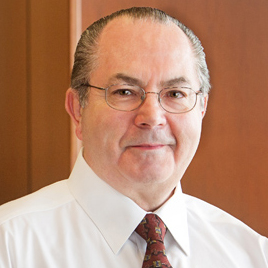 Michael E. Crawford, MD