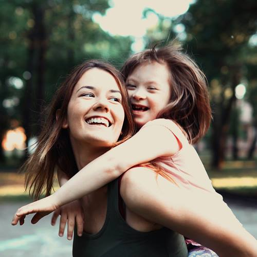 Little-Girl-With-Special-Needs-And-Mom
