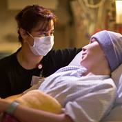 A nurse comforts a cancer patient
