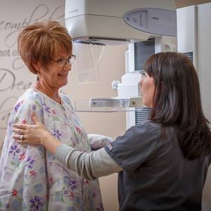 A woman gets a regular mammogram