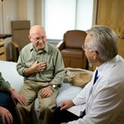 A physician helps a stroke patient
