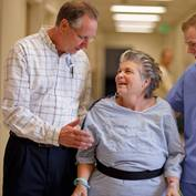 A rehabilitation specialist works with a stroke patient