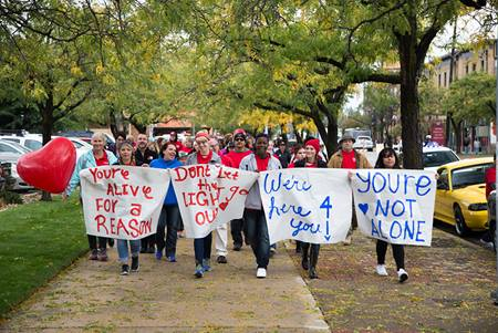 Hope Squad Students holding hopeful signs at the 2016 NUHOPE Walk