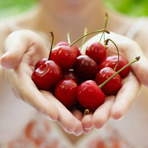 hands-holding-cherries-heart