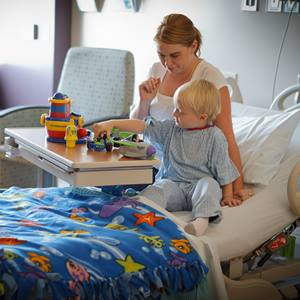 mother-sitting-with-toddler-hospital-bed