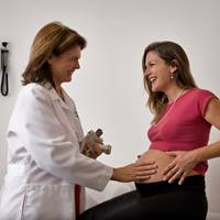 A pregnant woman is examined by her physician