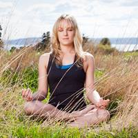 live-well-woman-meditating-outdoors-3631172-square