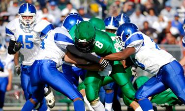 Football players tackle