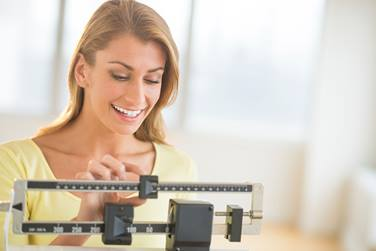 Stepping on the scales daily can increase weight loss