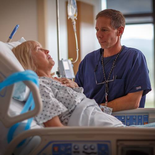 A stroke patient explains her condition to a nurse