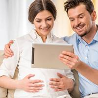 An expecting mother and father take an online childbirth class